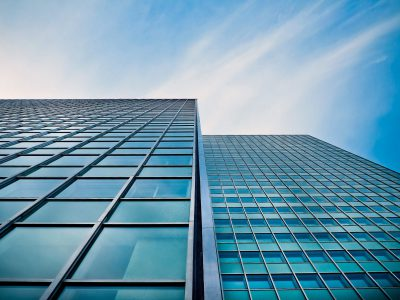 low-angle-view-of-office-building-against-blue-sky-248877